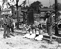 U.S. Marines guarding three captured North Koreans, ca. 1950.  Sgt. W. M. Compton.  (Marine Corps)<br /> Exact Date Shot Unknown<br /> NARA FILE #:  127-N-A3597<br /> WAR & CONFLICT BOOK #:  1490