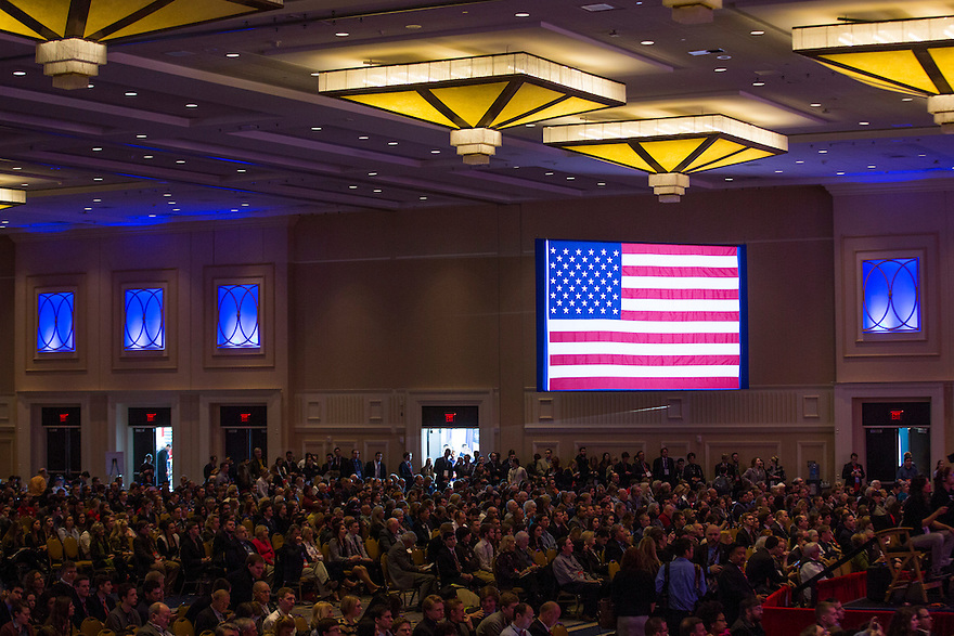 An American flag hangs over the crowd at Conservative Political Action Conference (CPAC) outside Washington, DC