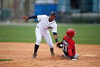 Detroit Tigers Dixon Machado (49) can not come up with the throw as Jason Martinson (11) slides into second base during a minor league Spring Training game against the Washington Nationals on March 28, 2016 at Tigertown in Lakeland, Florida.  (Mike Janes/Four Seam Images)