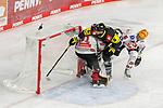 Krefelds Lucas Lessio (Nr.6) im Zweikampf mit Bremerhavens DOMINIKUHER (Nr.26) kollidiert mit Bremerhavens BRANDONMAXWELL (Nr.31)  beim Spiel in der Gruppe Nord der DEL, Krefeld Pinguine (schwarz) – Fischtown Pinguins Bremerhaven (weiss).<br /> <br /> Foto © PIX-Sportfotos.de *** Foto ist honorarpflichtig! *** Auf Anfrage in hoeherer Qualitaet/Aufloesung. Belegexemplar erbeten. Veroeffentlichung ausschliesslich fuer journalistisch-publizistische Zwecke. For editorial use only.