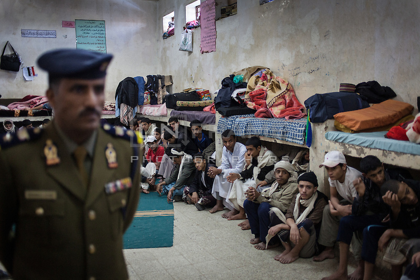 Mohammed Al-Awadai, the manager of juvenile administration in Yemen's prison authority, stands in one of two communal cells in the juvenile wing of Sanaa's Central Prison. There are 77 juvenile inmates in the prison, 35 of them are in high risk of being executed.