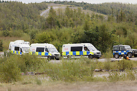 Pictured: Police vans on site. Monday 31 August 2020<br /> Re: Around 70 South Wales Police officers executed a dispersal order at the site of an illegal rave party, where they confiscated sound gear used by the organisers in woods near the village of Banwen, in south Wales, UK.