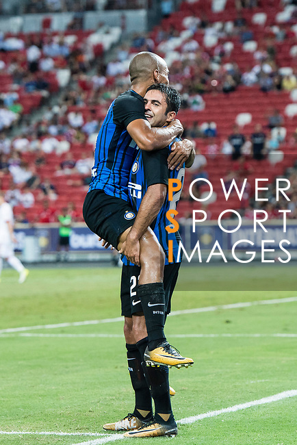 FC Internazionale Forward Eder Citadin Martins (R) celebrating his score with FC Internazionale Midfielder Joao Mario (L) during the International Champions Cup match between FC Bayern and FC Internazionale at National Stadium on July 27, 2017 in Singapore. Photo by Marcio Rodrigo Machado / Power Sport Images