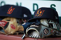 Bowling Green Hot Rods caps sit on top of gloves in the visitors dugout during the game against the Fort Wayne TinCaps at Parkview Field on August 20, 2019 in Fort Wayne, Indiana. The Hot Rods defeated the TinCaps 6-5. (Brian Westerholt/Four Seam Images)