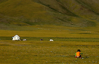 When nature calls, a young child doing its thing and so has everybody else no trees at 4800 meters near Naqu in Tibet, a nomads tent in the background.