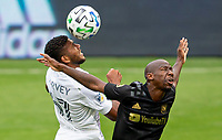 LOS ANGELES, CA - OCTOBER 25: Bradley Wright-Phillips #66 of LAFC and Carlos Harvey #67 of the Los Angeles Galaxy in the air for a ball during a game between Los Angeles Galaxy and Los Angeles FC at Banc of California Stadium on October 25, 2020 in Los Angeles, California.