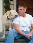 BETHANY,  CT-122816JS08--Marc Gerte plays with his 5-year-old Yellow Lab Jamie Lee on Wednesday. Gerte recently won a court battle alleging that was dog was taken by the Naugatuck Police and given away. <br /> Jim Shannon Republican-American