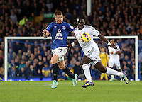 Liverpool, UK. Saturday 01 November 2014<br /> Pictured: Bafetimbi Gomis of Swansea (R) chalenged by James McCarthy of Everton. <br /> Re: Premier League Everton v Swansea City FC at Goodison Park, Liverpool, Merseyside, UK.