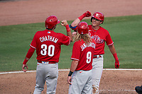 Philadelphia Phillies Nick Maton (67) celebrates hitting a home run with C.J. Chatham (30) and Travis Jankowski (9) during a Major League Spring Training game against the Baltimore Orioles on March 12, 2021 at the Ed Smith Stadium in Sarasota, Florida.  (Mike Janes/Four Seam Images)