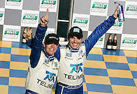 Scott Pruett, left, and Memo Rojas celebrate their win in the Montreal 200, Circuit Gilles Villenueve, Montreal, Quebec, Canada, August 2010.  (Photo by Brian Cleary/www.bcpix.com)