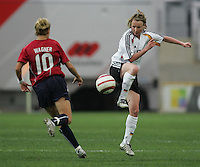MAR 15, 2006: Faro, Portugal:  German midfielder (8) Conny Pohlers passes the ball away from USWNT midfielder (10) Aly Wagner in the finals of the Algarve Cup in Faro, Portugal.