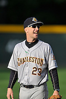 Coach Travis Chapman (23) of the Charleston RiverDogs in a game against the Greenville Drive on Tuesday May 17, 2016, at Fluor Field at the West End in Greenville, South Carolina. Greenville won, 4-2. (Tom Priddy/Four Seam Images)