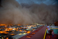 Apr. 26, 2011; Phoenix, AZ, USA; A family looks on as a dust storm converges on downtown Phoenix. Chase Field in Phoenix is hosting the 2011 All Star Game. Mandatory Credit: Mark J. Rebilas-