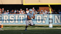 CHAPEL HILL, NC - SEPTEMBER 28: Sam Howell #7 of the University of North Carolina runs with the ball during a game between Clemson University and University of North Carolina at Kenan Memorial Stadium on September 28, 2019 in Chapel Hill, North Carolina.