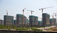 Yangzhou, Jiangsu, China.  Construction Boom.  New Apartments under Construction.