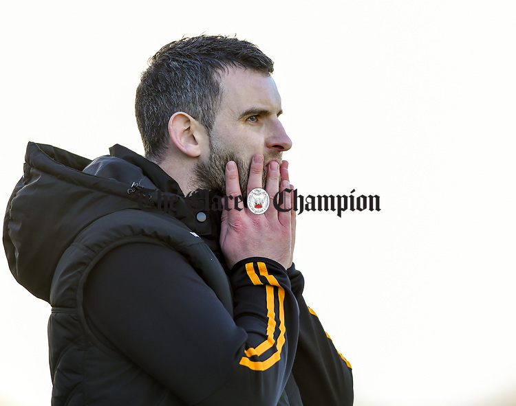 A tense Ballyea manager Kevin Sheehan in the final minutes of the county senior hurling final against Cratloe at Cusack Park. Photograph by John Kelly.