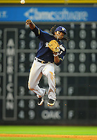 Apr. 30, 2011; Houston, TX, USA: Milwaukee Brewers second baseman Rickie Weeks makes a leaping throw to first base in the eighth inning against the Houston Astros at Minute Maid Park. Mandatory Credit: Mark J. Rebilas-