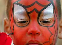A young boy gets his face painted during an event at Birkdale Village in Huntersville, NC. Birkdale Village combines the best of shopping, dining, apartments and entertainment venues within a 52-acre mixed-use development.
