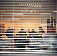 UK. Berlely. 7th December 2010..A meeting of staff..©Andrew Testa/Panos for the Sunday Times Magazine..