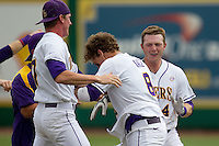 LSU Tigers outfielder Raph Rhymes #4 celebrates with teammate Mason Katz #8 following the conclusion their NCAA Super Regional baseball game against Stony Brook on June 9, 2012 at Alex Box Stadium in Baton Rouge, Louisiana. LSU defeated Stony Brook 5-4 in 12 innings. (Andrew Woolley/Four Seam Images)