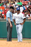 Buffalo Bisons manager Wally Backman #8 questions a call from umpire Mike Estabrook during a game against the Columbus Clippers at Coca-Cola Field on May 31, 2012 in Buffalo, New York.  Columbus defeated Buffalo 3-0.  (Mike Janes/Four Seam Images)