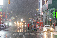 NEW YORK, NEW YORK - JANUARY 31: People walk around Times Square during the pass of the snowstorm on January 31, 2021 in New York City. New York City Mayor Bill de Blasio declared a state of emergency order due to the arriving storm that's expected to wallop New York, where airports are expected to cancel the majority if their flights. (Photo by Eduardo MunozAlvarez/VIEWpress)