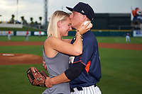 Tampa Yankees pitcher Andrew Schwaab kisses his fiancé Lauren Stoeckle on the forehead after proposing during pre-game first pitch ceremonies before the Florida State League All-Star Game on June 17, 2017 at Joker Marchant Stadium in Lakeland, Florida.  FSL North All-Stars  defeated the FSL South All-Stars  5-2.  (Mike Janes/Four Seam Images)