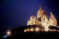 Sacre Coeur lit up at night with flood lights, Paris, France.