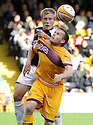 03/10/2009  Copyright  Pic : James Stewart.sct_jspa_14_motherwell_v_falkirk  .SCOTT ARFIELD GETS A HOLD OF STEVEN HAMMELL.James Stewart Photography 19 Carronlea Drive, Falkirk. FK2 8DN      Vat Reg No. 607 6932 25.Telephone      : +44 (0)1324 570291 .Mobile              : +44 (0)7721 416997.E-mail  :  jim@jspa.co.uk.If you require further information then contact Jim Stewart on any of the numbers above.........
