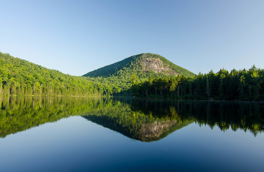 Mt Webster Slide with its huge cliff over Wachipauka Pond in summer.