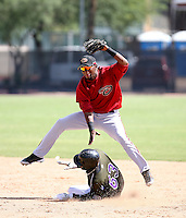 Reynaldo Navarro / Arizona  Diamondbacks 2008 Instructional League - Navarro leaps over Colorado Rockies baserunner Delta Cleary to complete a double play in the game at Reid Park, Tucson, AZ - 10/5/2008...Photo by:  Bill Mitchell/Four Seam Images