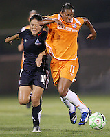 Homare Sawa#10 of the Washington Freedom pushes into Rosana#11 of Sky Blue FC during a WPS match at Maryland Soccerplex on August 8,2009 in Boyds, Maryland. Freedom won 3-1