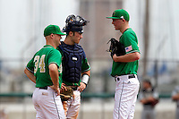 Notre Dame Fighting Irish assistant coach Chuck Ristano #34 talks with catcher Joe Hudson #4 and pitcher Matt Temowchek #42 during a game against the Purdue Boilermakers at the Big Ten/Big East Challenge at Al Lang Stadium on February 19, 2012 in St. Petersburg, Florida.  (Mike Janes/Four Seam Images)
