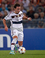 Calcio, Champions League, Gruppo E: Roma vs Bayern Monaco. Roma, stadio Olimpico, 21 ottobre 2014.<br /> Bayern's Mario Goetze in action during the Group E Champions League football match between AS Roma and Bayern at Rome's Olympic stadium, 21 October 2014.<br /> UPDATE IMAGES PRESS/Isabella Bonotto