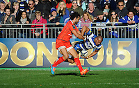 Jonathan Joseph of Bath Rugby tussles with Yoann Huget of Stade Toulousainduring the European Rugby Champions Cup  Round 2 match between Bath Rugby and Stade Toulousain at The Recreation Ground on Saturday 25th October 2014 (Photo by Rob Munro)