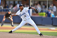 Asheville Tourists starting pitcher Antonio Santos (10) deliver a pitch during a game against the Greensboro Grasshoppers at McCormick Field on May 11, 2018 in Asheville, North Carolina. The Tourists defeated the Grasshoppers 10-5. (Tony Farlow/Four Seam Images)