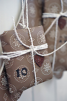 Gifts on the advent calendars are decorated with white string, red wax seals and an embossed number for each day