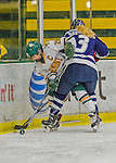 14 February 2015: University of Vermont Catamount Defender Sarah Campbell, a Senior from Saratoga Springs, NY, in first period action along the boards against the University of New Hampshire Wildcats at Gutterson Fieldhouse in Burlington, Vermont. The Lady Catamounts rallied from a 3-1 deficit to earn a 3-3 tie in the final home game of their NCAA Hockey East season. Mandatory Credit: Ed Wolfstein Photo *** RAW (NEF) Image File Available ***