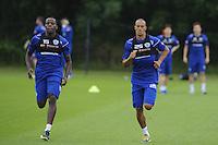 Bobby Zamora and Nedum Onuoha of QPR team in training
