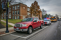 A Westerville police officer writes a parking violation for a truck parked in a school zone.