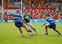27th March 2021; Brentford Community Stadium, London, England; Gallagher Premiership Rugby, London Irish versus Bath;  Paddy Jackson of London Irish being marked by Johnathan Joseph and Orlando Bailey of Bath