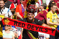 A Belgium fan with a red devil scarf