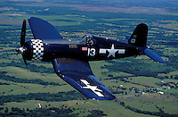 Capt. Vaughn Olsen flies a WWII vintage F4U Corsair over Texas. The aircraft is owned by the Confederate Air Force, a historical museum dedicated to rebuilding and flying WWII aircraft. Aviation, planes,. Dallas TX USA.