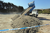 FAO JANET TOMLINSON, DAILY MAIL PICTURE DESK<br />Pictured: Soil is being unloaded by a tipper lorry so that special forensics police officers can search through in a field in Kos, Greece. Sunday 02 October 2016<br />Re: Police teams led by South Yorkshire Police, searching for missing toddler Ben Needham on the Greek island of Kos have moved to a new area in the field they are searching.<br />Ben, from Sheffield, was 21 months old when he disappeared on 24 July 1991 during a family holiday.<br />Digging has begun at a new site after a fresh line of inquiry suggested he could have been crushed by a digger.