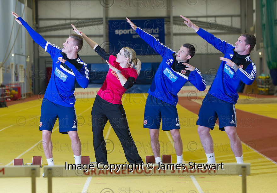 Scots Athlete Eilidh Child takes Hearts' players Kevin McHattie, Dale Carrick and Jack Hamilton, through their paces at Grangemouth Stadium.