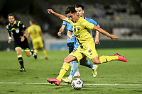 8th February 2021; Jubilee Stadium, Sydney, New South Wales, Australia; A League Football, Sydney Football Club versus Wellington Phoenix; Mirza Muratovic of Wellington Phoenix  shoots as Alexander Baumjohann of Sydney tries to cover