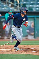 Luis Liberato (51) of the Tacoma Rainiers hustles to first base against the Salt Lake Bees at Smith's Ballpark on May 13, 2021 in Salt Lake City, Utah. The Rainiers defeated the Bees 15-5. (Stephen Smith/Four Seam Images)