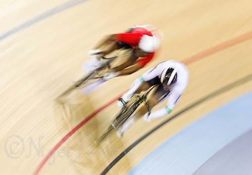19 FEB 2012 - LONDON, GBR - Trinidad and Tobago's Phillip Njisane (TRI) (on left in red and white) and Australia's Scott Sunderland (AUS) (on right in white and black) race for the line during their Men's Sprint B Semi Final during the UCI Track Cycling World Cup, and London Prepares test event for the 2012 Olympic Games, in the Olympic Park Velodrome in Stratford, London, Great Britain .(PHOTO (C) 2012 NIGEL FARROW)
