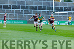 Kerry's Michael O'Gara been chased by Ryan Monahan and Matthew Tierney of  Galway in the U20 All Ireland football semi final.