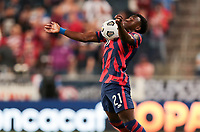 KANSAS CITY, KS - JULY 15: George Bello #21 of the United States traps the ball during a game between Martinique and USMNT at Children's Mercy Park on July 15, 2021 in Kansas City, Kansas.